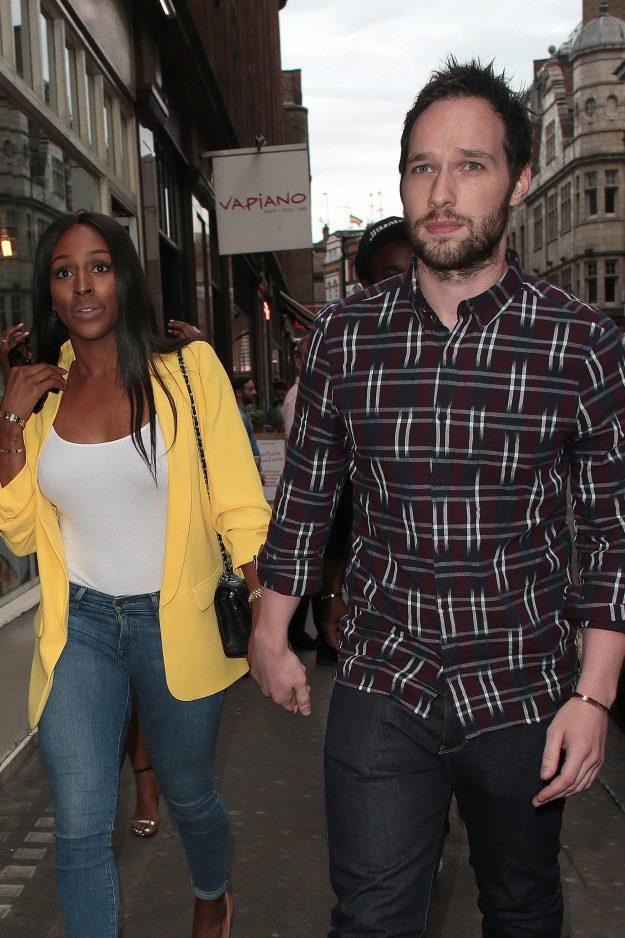 Alexandra Burke and boyfriend Josh holding hands