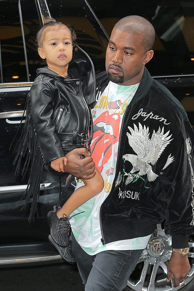 Kanye west and Kim Kardashian arrive with baby chicago west