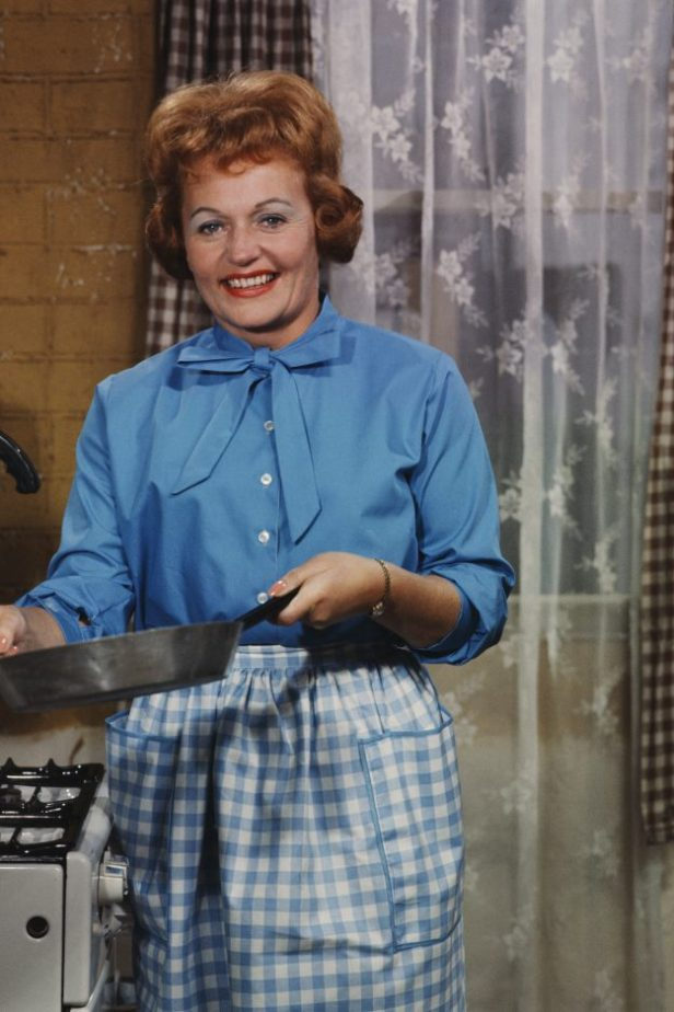 Irish actress Doreen Keogh pictured in character as Concepta Riley (previously Concepta Hewitt) holding a saucepan on the set of the television soap opera Coronation Street in Manchester in 1962. (Photo by Popperfoto/Getty Images)