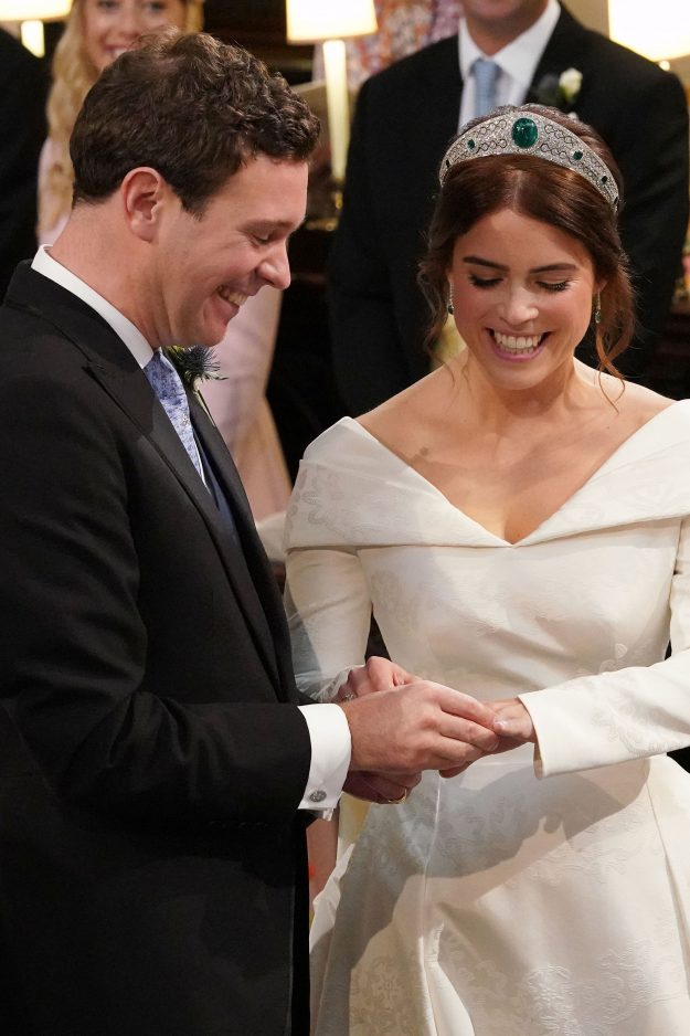 WINDSOR, ENGLAND - OCTOBER 12: Jack Brooksbank and Princess Eugenie of York exchange rings during their wedding ceremony at St. George's Chapel on October 12, 2018 in Windsor, England. (Photo by Jonathan Brady - WPA Pool/Getty Images)