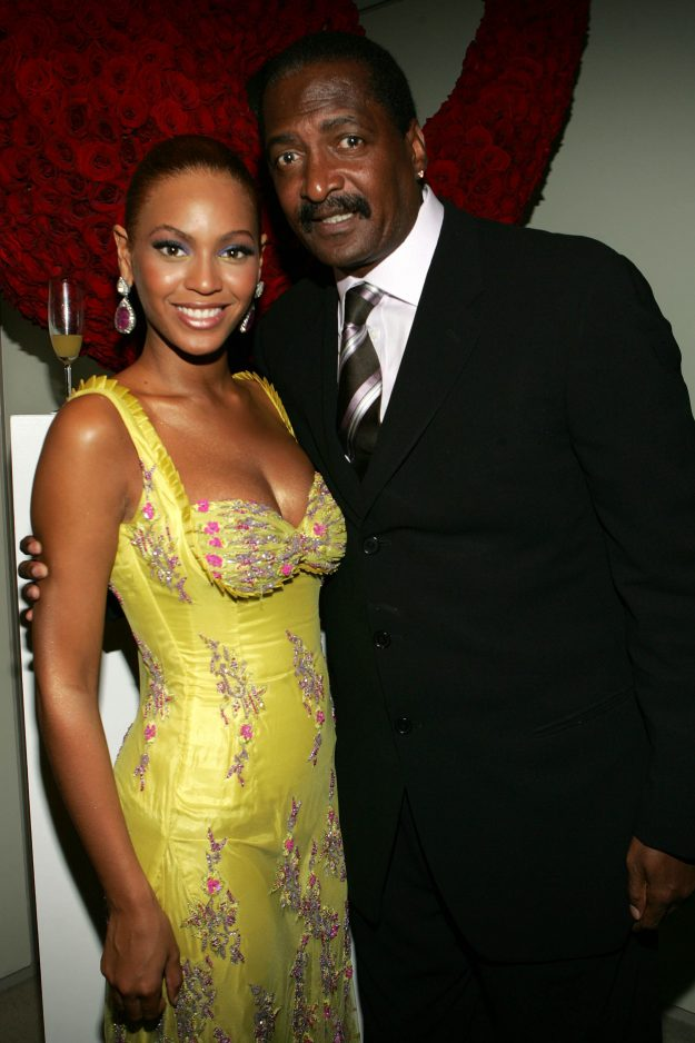 Beyonce Knowles poses with her father Mathew Knowles in 2005