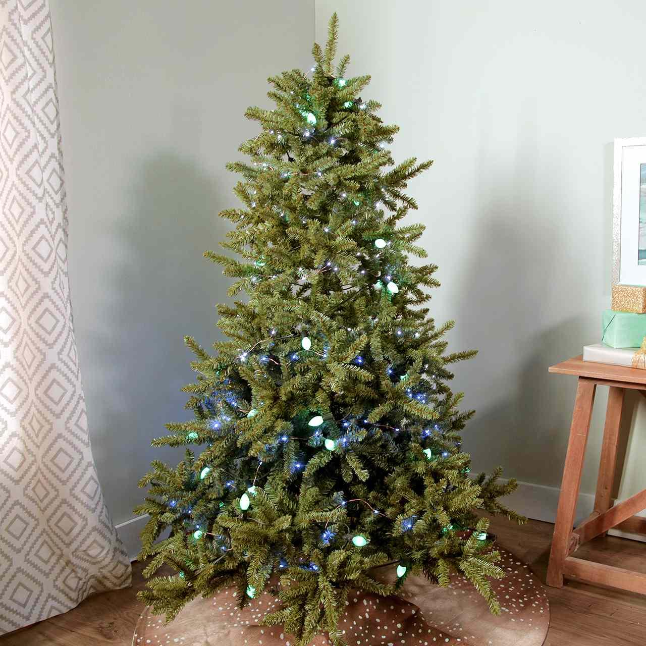 hight resolution of hanging christmas lights on tree video still