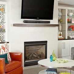 How To Decorate Living Room With Tv Over Fireplace Printed Chairs Tvs Fireplaces Grey And Orange Large Mounted On Wall