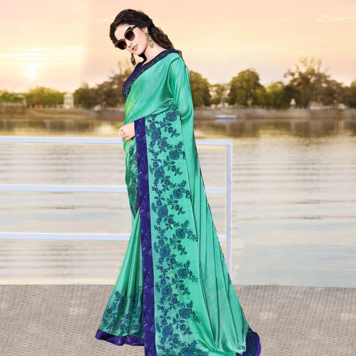 Entrancing Turquoise Green Colored Partywear Embroidered Georgette Saree