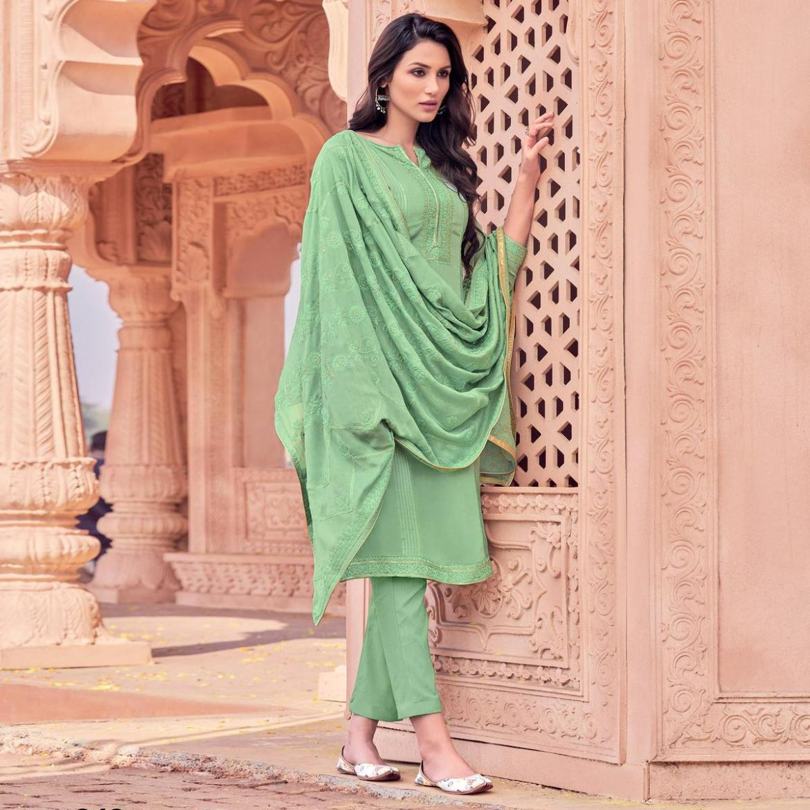 Adorable Classy Green Colored Embroidered Partywear Viscose Muslin Suit