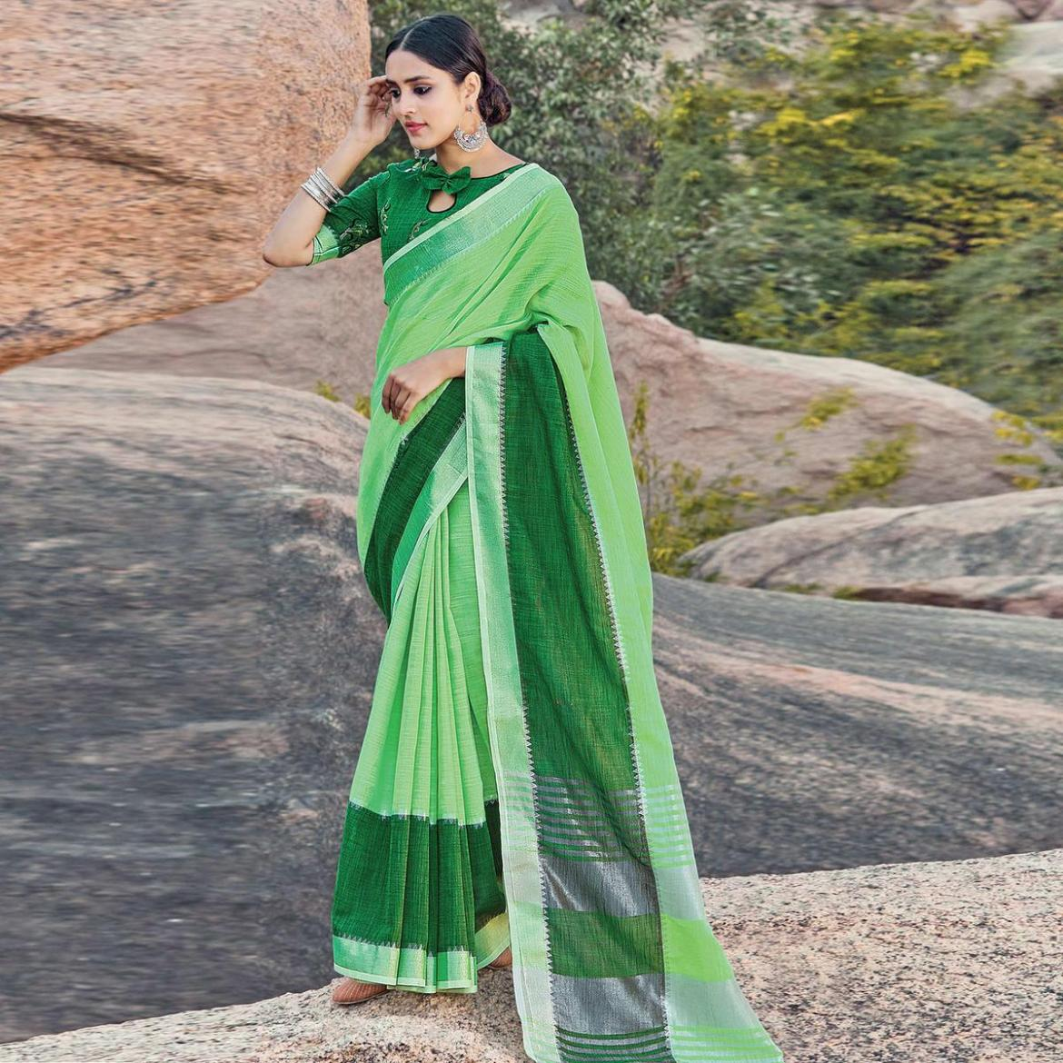 Engrossing Green Colored Festive Wear Woven Linen Saree