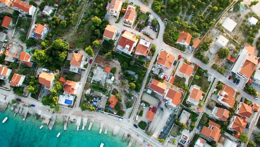 An aerial image of sea-side houses.