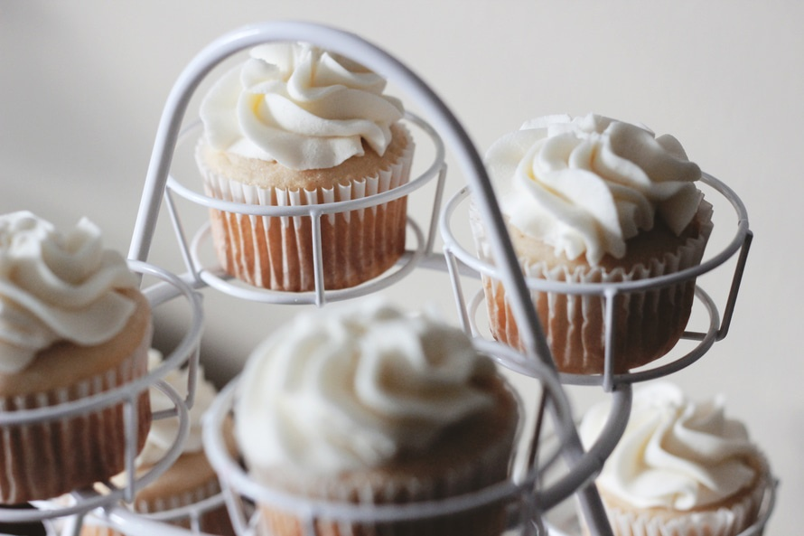 White Icing Brown Cupcake on White Metal