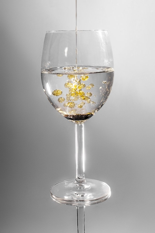 Clear Long Stem Wine Glass With Yellow Liquid Free Stock