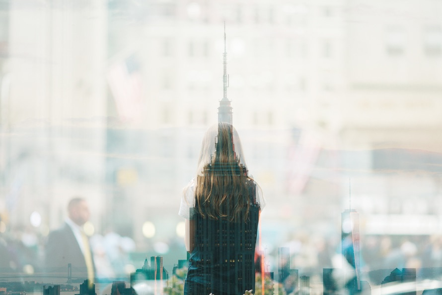 Multiple exposure of building and a girl