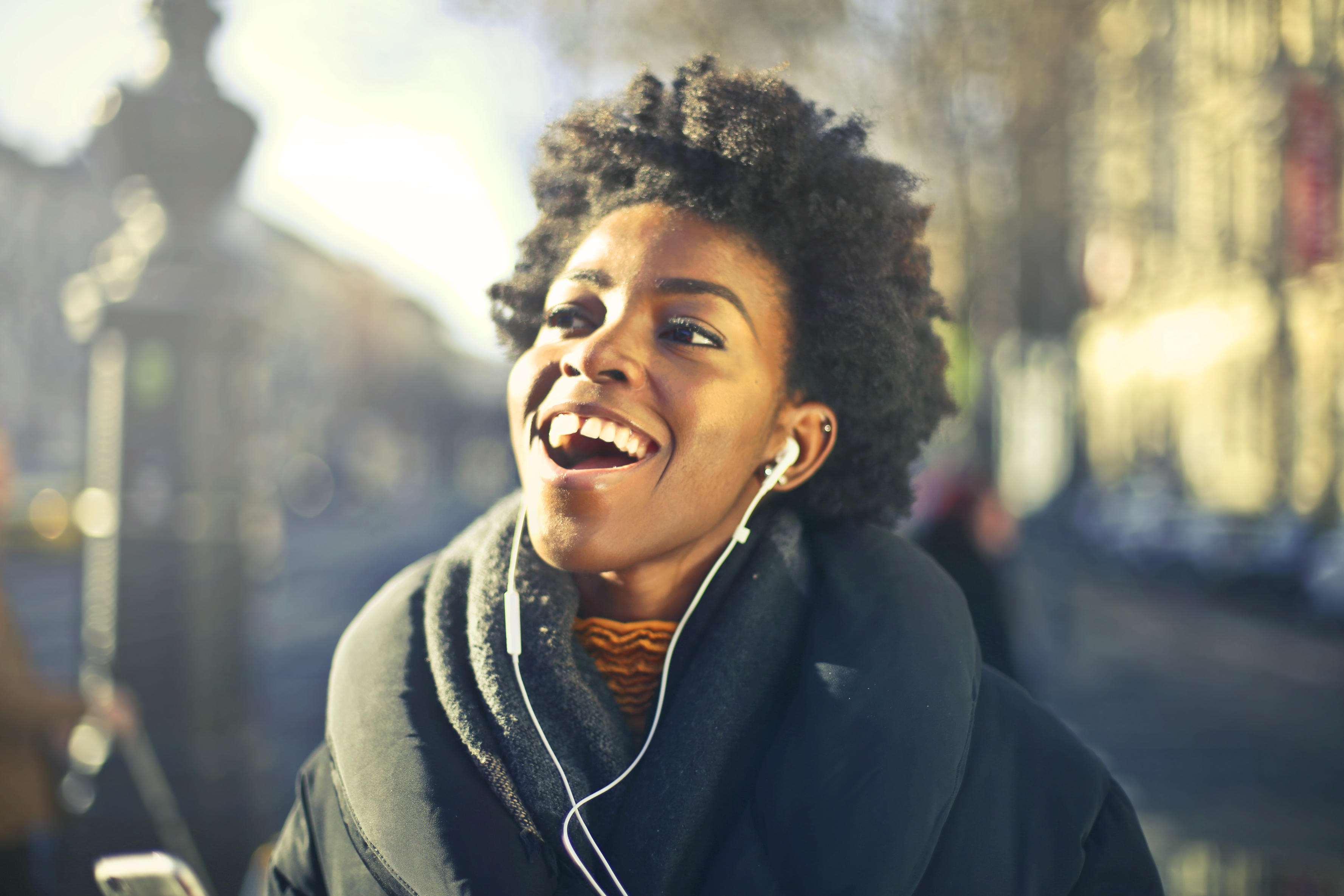 Close Up Photo Of A Woman Listening To Music Free Stock