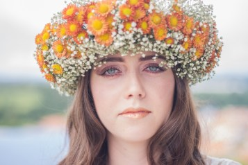 Woman Using White and Orange Floral Hat