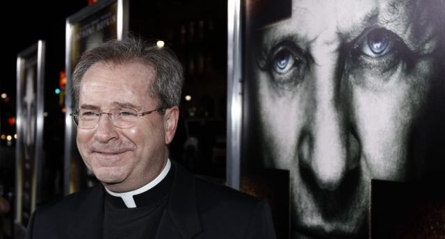 """Father Gary Thomas arrives at the premiere of """"The Rite"""" in Los Angeles."""