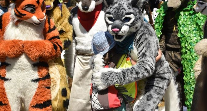 "a large group of people dressed up as animals in ""furry"" sexual identity."