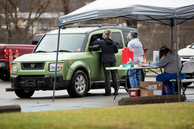 The Wayne County Health Department administers Covid-19 vaccines to adults 80 years and older at a drive-thru site Dec. 31 in Wayne, W.Va.