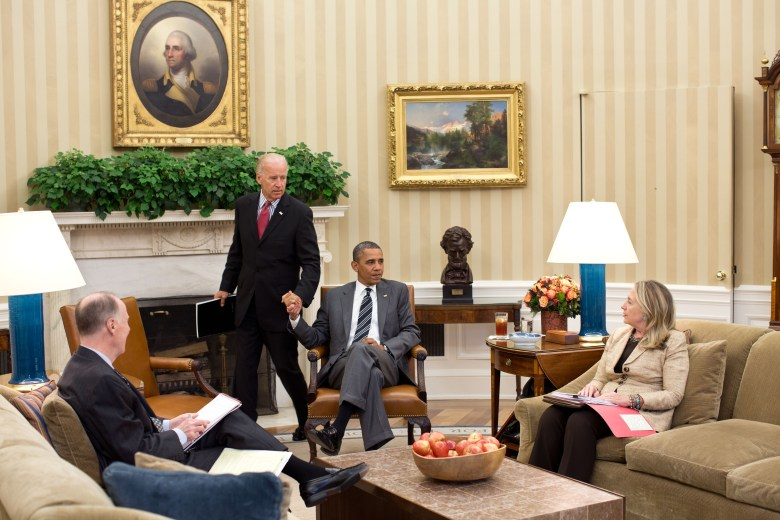 Vice President Joe Biden arrives for a meeting with President Barack Obama (center), Secretary of State Hillary Clinton (right) and National Security Advisor Tom Donilon (left) in the Oval Office in 2012.