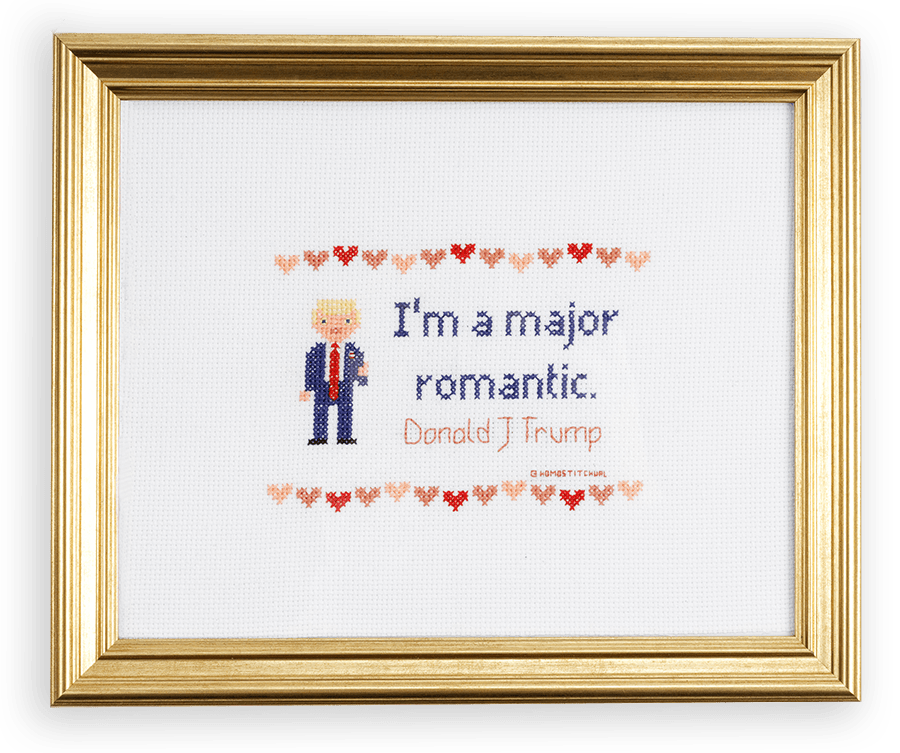 """A cross stitched Donald Trump with a quote by him that reads, """"I'm a major romantic."""""""