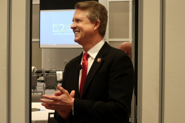 Rep. Roger Marshall awaits the start of a debate | AP Photo