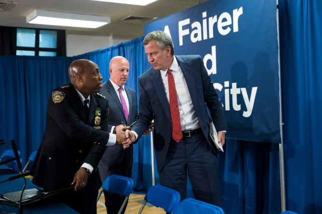 NYPD Chief of Patrol Rodney Harrison, New York City Police Commissioner James O'Neill and New York City Mayor Bill de Blasio depart a news conference.