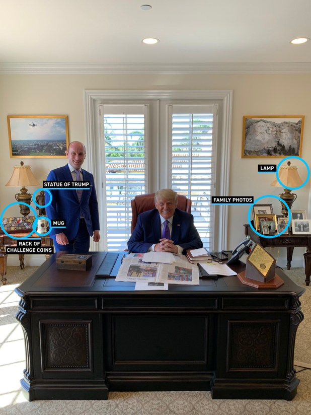 President Trump sits at his desk in his Mar-a-Lago office, surrounded by notable items.  Items on the back tables, such as a Trump statue and family photos, are circled.