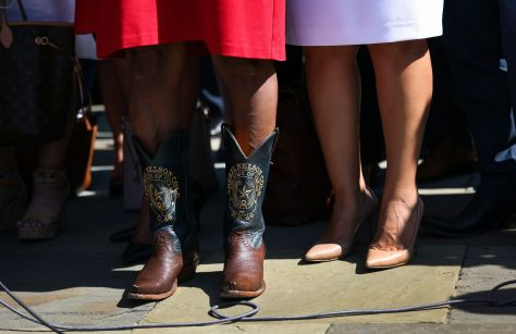 Texas state House Democrat Rep. Sheryl Cole wears cowboy boots during a news conference outside the U.S. Capitol, Tuesday.