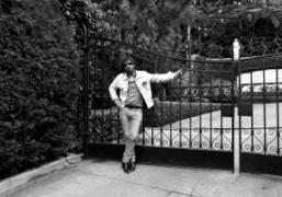 Olivier Zahmoutside of the gates of thePlayboy Mansion, Los Angeles.Photo Brad Elterman