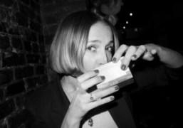 StylistAleksandra Woroniecka drinking sake at Omen,New York. Photo Olivier Zahm