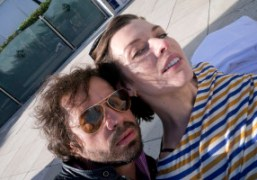 Milla Jovovich and Oliver Zahm by the pool at the Hotel Martinez,...