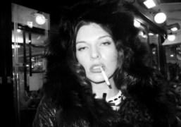 Milla Jovovich smoking outside the Café de Flore, Paris. Photo Olivier Zahm