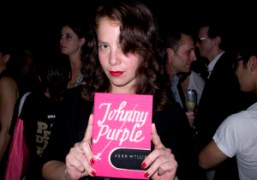 Olympia Le-Tan holding the Purple bag that she designed to be sold…