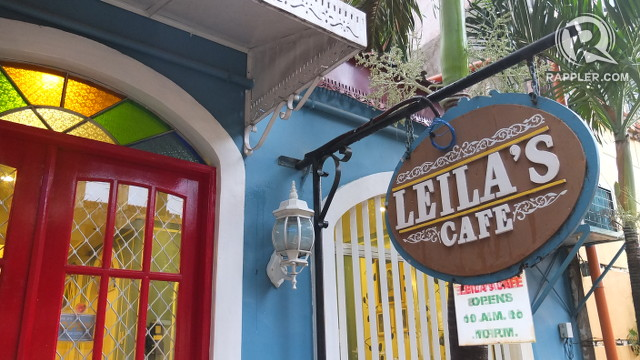 SPOT OF COLOR. Leila's bright door welcomes guests cheerfully