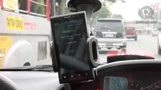 MAKE SURE TO SEE THIS. A Cloud phone with the GrabTaxi app is installed in the cab's windshield
