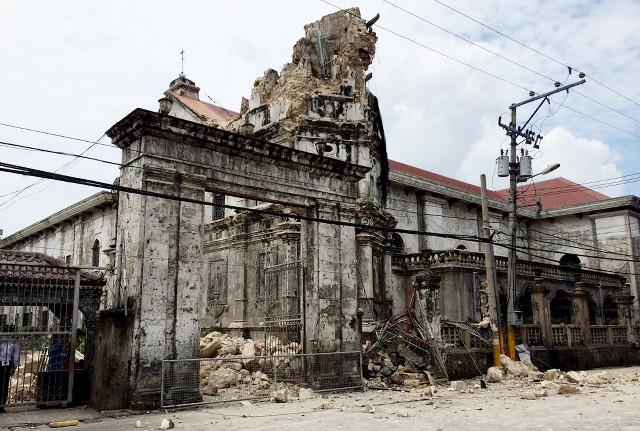 NATIONAL TREASURE. Basilica Minore del Sto Niño in Cebu City loses its belfry to the 7.2-magnitude earthquake. Photo from Jose Faruggia