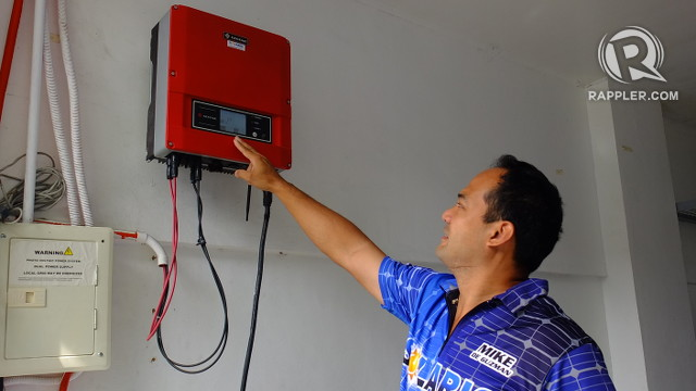 SUN-POWERED. Mike De Guzman has installed a device that turns electricity generated by his solar panels into a form that can power his appliances. All photos by Pia Ranada/Rappler