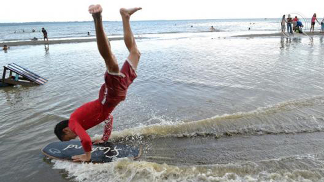 Skimboarding can be both challenging and acrobatic.