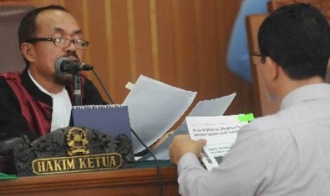 Hakim Sarpin Rizaldi memutuskan Komjen Budi Gunawan tak bersalah di PN Jaksel, Senin (16/2).