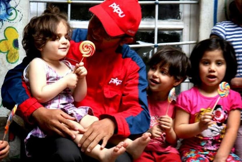 PKPU memberikan bantuan untuk pengungsi Suriah.