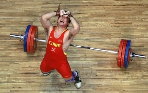 Lu Yong of China reacts after a missed attempt during the men's 85kg weightlifting event at the 16th Asian Games in Guangzhou, Guangdong province, China, November 17, 2010. REUTERS/Mick Tsikas