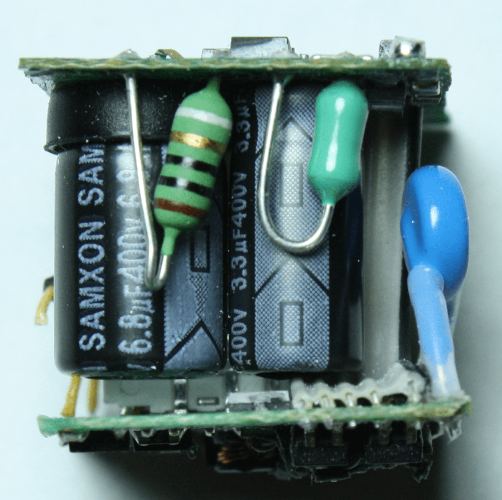 medium resolution of apple iphone charger showing the fusible resistor striped inductor green
