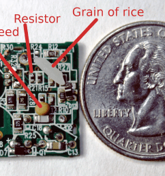 apple iphone charger circuit board compared to a mustard seed grain of rice and [ 2838 x 1700 Pixel ]