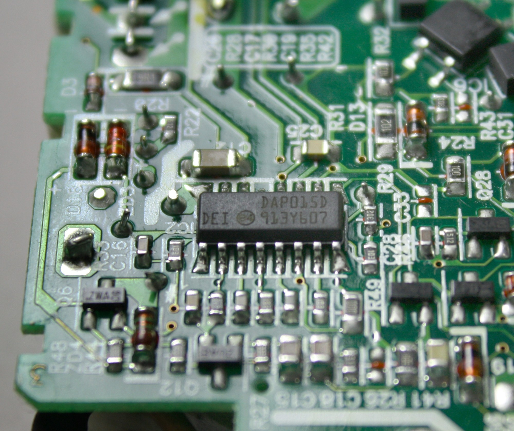 hight resolution of the circuit board inside the macbook charger the chip in the middle controls the switching