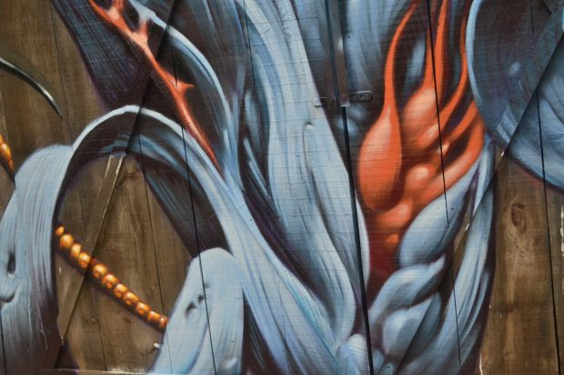 Close-up of Aaron Horkey's mural showing the incredible detail he created using spray paint.