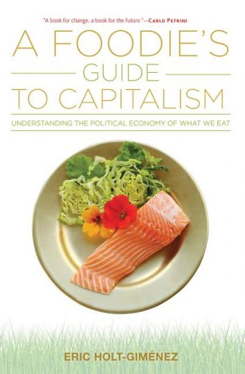 Book cover for A Foodie's Guide to Capitalism shows a plate of salmon with a salad garnished with a flower.