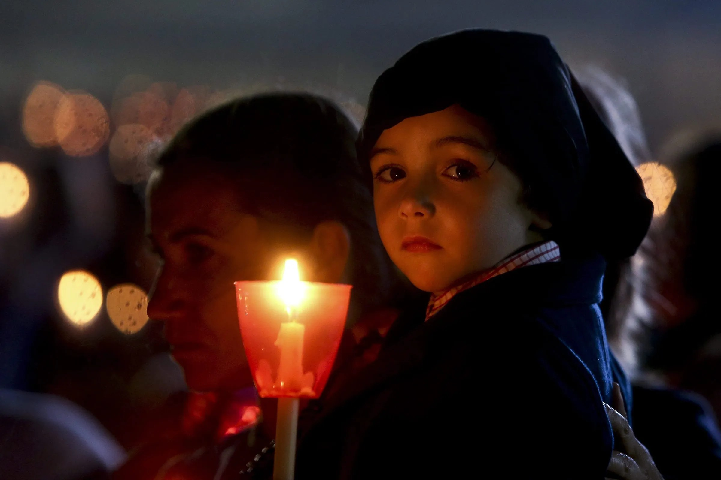 A child holds a candle in the Candles Procession during the annual pilgrimage to Fatima Sanctuary in Fatima, Portugal, May 12, 2015.  (PAULO NOVAIS / EPA)