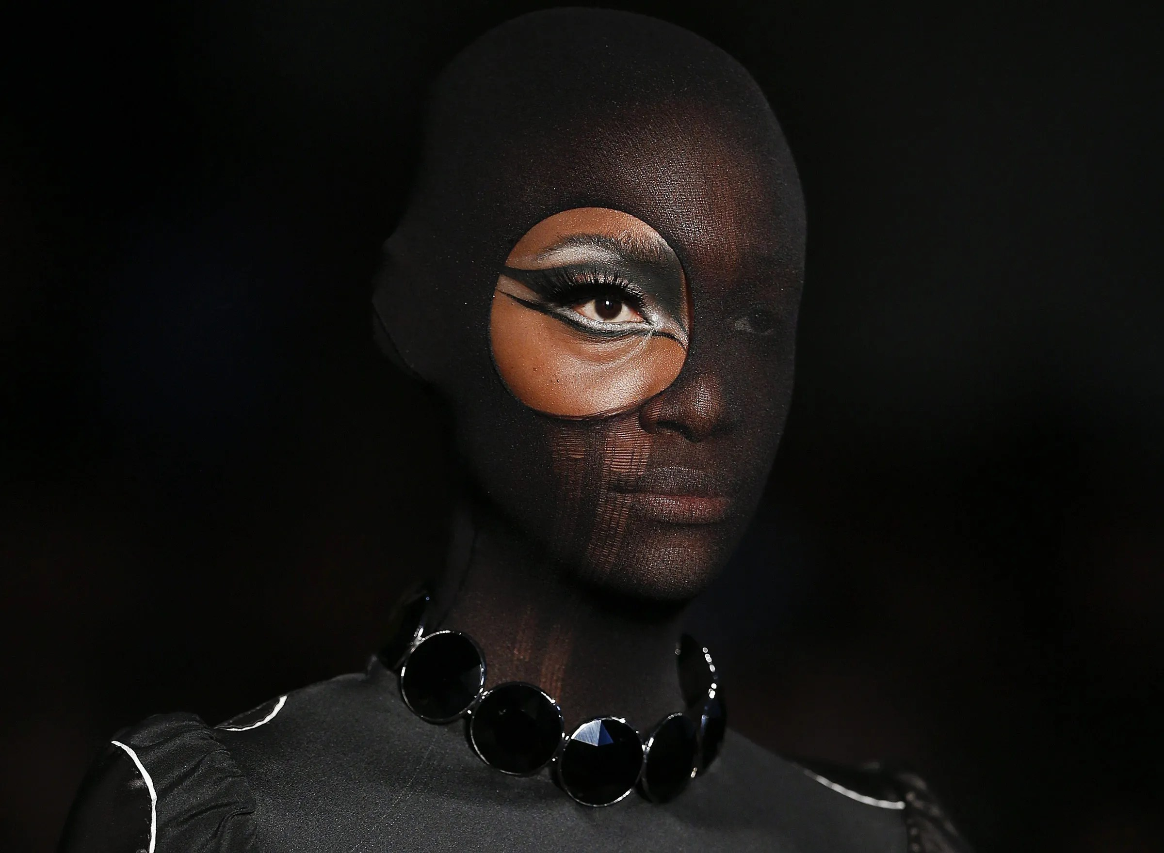 A model wears a creation from the Alexandre Herchcovitch winter collection during the Sao Paulo Fashion Week in Sao Paulo, Brazil, Sunday, Oct. (AP Photo/Andre Penner)