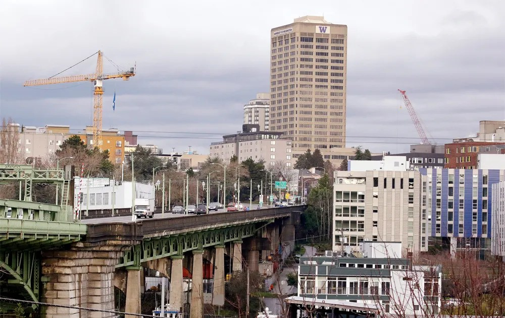 Cranes tower above Seattle's University District neighborhood as a building boom continues there. (Elaine Thompson / The Associated Press)