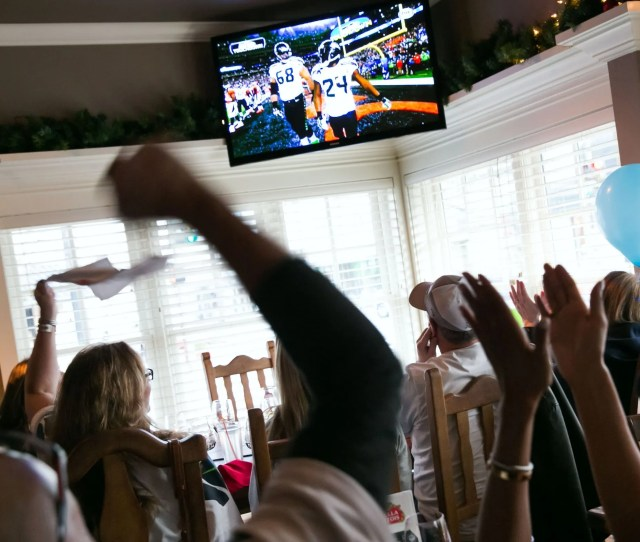 Fans Celebrate After The Seahawks Score A Touchdown Against The Broncos During Super Bowl Xlviii On