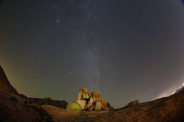 Stars light up the sky above campers, over the rock of Seoraksan Mountain, 250 kilometers northeast of Seoul, South Korea, October 30, 2016.