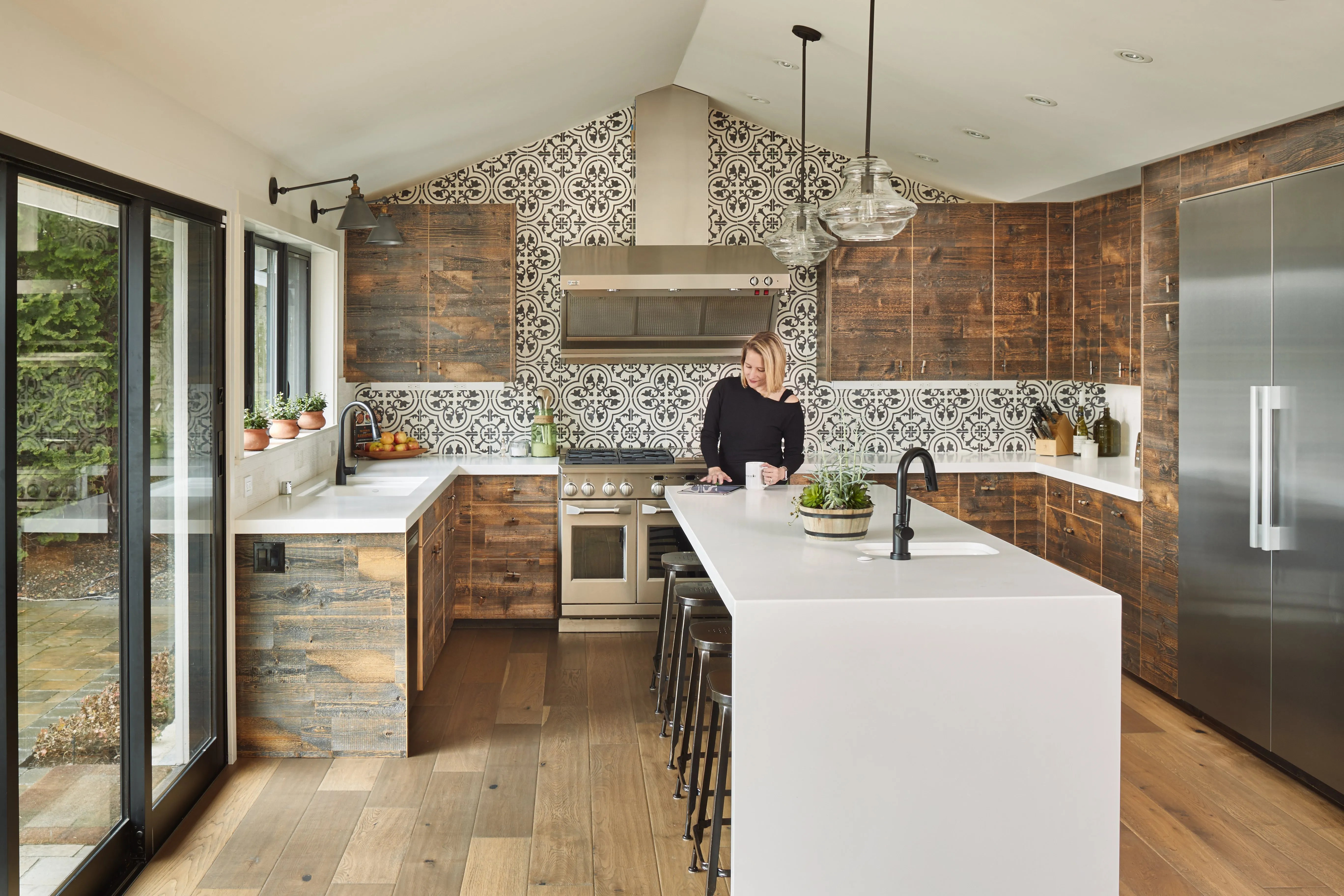 updated kitchens kitchen counter lights an extreme fixer-upper in bellevue gets a beautiful ...