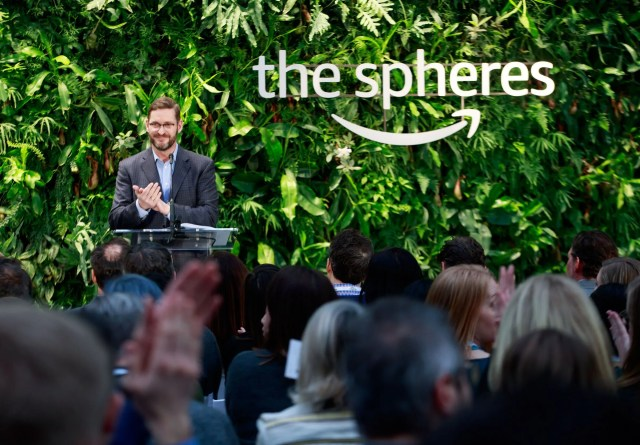 John Schoettler, Amazon's top real estate executive,  speaks at the opening of the Spheres on Amazon's campus last year. Schoettler connected the company with Northwest Center in 2002. Besides directing job candidates to Amazon, Northwest Center also provides services to the company — including greeters at the Spheres. (Erika Schultz / The Seattle Times, 2018)